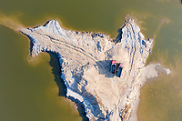 Two trucks sit on a small peninsula on aquaculture farmland near the city of Huanghua, south of Tianjin. This area of coastline has been identified as being particularly vulnerable to coastal erosion on will increasingly be threatened as sea levels rise and storm surges increase. 2019