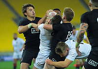 North's Beauden Barrett and Damien McKenzie try to rip the ball from South's Brad Weber during the rugby match between North and South at Sky Stadium in Wellington, New Zealand on Saturday, 5 September 2020. Photo: Dave Lintott / lintottphoto.co.nz