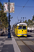 San Francisco, California - Street Car on the Embarcadero, near the Ferry Building.  San Francisco has acquired street cars from all over the world, refurbished them, and placed them into service.  Electric power reduces air pollution.