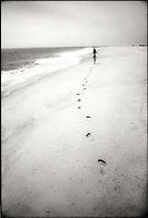 Woman running on beach<br />