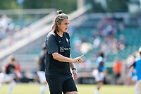 CARY, NC - SEPTEMBER 12: Portland Thorns goalkeeping coach Nadine Angerer assists with warm-ups before a game between Portland Thorns FC and North Carolina Courage at WakeMed Soccer Park on September 12, 2021 in Cary, North Carolina.