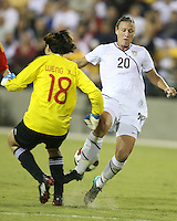 Abby Wambach #20 of the USA WNT loses the ball to Luna Huang #18 of the PRC WNT during an international friendly match at KSU Soccer Stadium, on October 2 2010 in Kennesaw, Georgia. USA won 2-1.