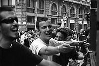 Milano, Mayday Parade, manifestazione del 1. maggio di gruppi e organizzazioni di sinistra contro il lavoro precario. La gioia di alcuni ragazzi che ballano davanti a un sound system in piazza Cordusio --- Milan, Mayday Parade, 1st of May manifestation of leftist groups and organizations against temporary work. The joy of some youngsters dancing at a sound system in Cordusio square