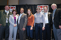 INDIANAPOLIS, IN - January 18, 2013: From left: 2002 and 2006 World Cup captain Claudio Reyna, 1991 World Cup captain and 2003 World Cup coach April Heinrichs, 1995 and 1999 World Cup coach Tony DiCicco, 1990 World Cup coach Bob Gansler, 1991 World Cup coach Anson Dorrance, 1998 World Cup coach Steve Sampson, 1999 World Cup captain Julie Foudy. U.S. Soccer hosted a World Cup Coaches and Captains panel at the Indiana Convention Center in Indianapolis, Indiana during the NSCAA Annual Convention.