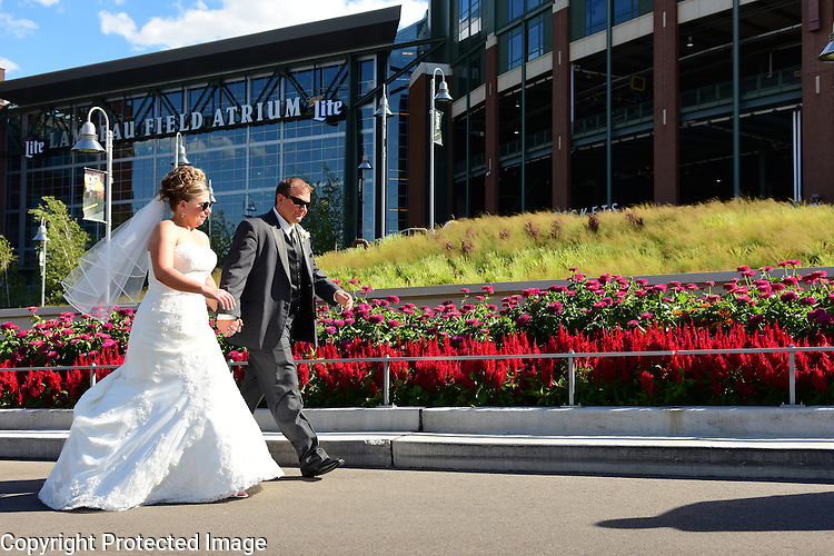 Corey Stevens and Joe Wollin wedding ceremony at First United Methodist Church in Green Bay, Wis., on August 1, 2015. The reception was held at the KI Convention Center following picture stops at Lambeau Field, downtown Riverwalk and other urban locales.