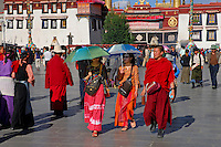 Pilgrims, monks, and Chinese tourists in Barkhor Square, the forecourt of the Jokhang Temple, Lhasa, Tibet.