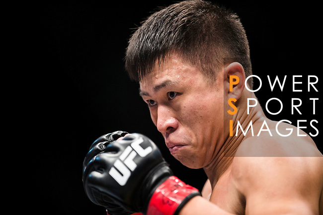 Wang Sai of China and Lipeng Zhang of China fight on their Welterweight Bout 3 Rounds during the UFC Fight Night at the Cotai Arena on 01 March 2014 in Macau, China. Photo by Victor Fraile / Power Sport Images