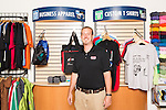 September 18, 2014. Raleigh, North Carolina.<br />  Chuck Sawyer poses for a portrait at his main retail and production franchise.<br />  Chuck Sawyer, 37, is the owner of three Instant Imprints franchises, specializing in promotional materials such as t-shirts,signs and mugs. Sawyer wishes he had more saved for retirement and is encouraging his none employees to start thinking about how they will save for when they get older.<br /> Publication: AARP Bulletin<br /> Editor: Jenna Isaacson-Fuller<br /> Model Released<br /> Portrait