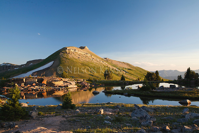Sunset on a small mounatain lake on top of a mountain pass in the beartooth wilderness area