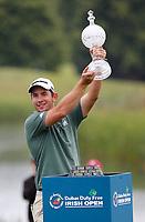 4th July 2021; Mount Juliet Golf Club, Kilkenny, Ireland; Dubai Duty Free Irish Open Golf, Day Four; Lucas Herbert of Australia raises the winners trophy