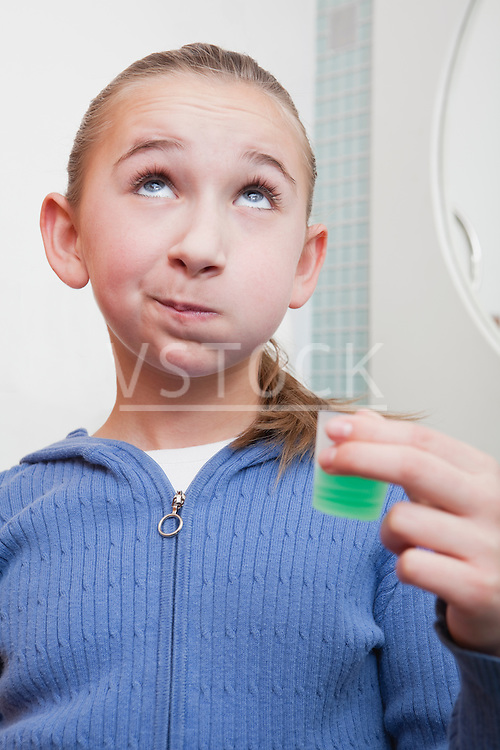 USA, Illinois, Metamora, Girl (10-11) rinsing teeth