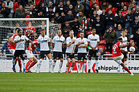 Britt Assombalonga of Middlesbrough (R) takes a free kick over the Swansea wall during the Sky Bet Championship match between Middlesbrough and Swansea City at the Riverside Stadium, Middlesbrough, England, UK. Saturday 22 September 2018