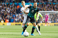 LEEDS, ENGLAND - AUGUST 31: (L-R) Liam Cooper of Leeds United challenges Borja Baston of Swansea City during the Sky Bet Championship match between Leeds United and Swansea City at Elland Road on August 31, 2019 in Leeds, England. (Photo by Athena Pictures/Getty Images)