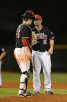 Ball State Cardinals pitcher Matt Johnson (16) talks with catcher Jarrett Rindfleish (25) during a game against the Mississippi Valley State Delta Devils on February 21, 2014 at North Charlotte Regional Park in Port Charlotte, Florida.  Ball State defeated Mississippi Valley 12-1.  (Mike Janes/Four Seam Images)