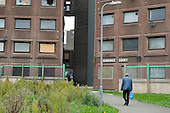 An elderly man returns to his home in a block scheduled for demolition on the Stonebridge Estate, in the London Borough of Brent. The estate is managed by the Stonebridge Housing Action Trust (HAT).
