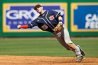 Auburn Tigers second baseman Jordan Ebert #23 makes a throw to first base against the LSU Tigers in the NCAA baseball game on March 24, 2013 at Alex Box Stadium in Baton Rouge, Louisiana. LSU defeated Auburn 5-1. (Andrew Woolley/Four Seam Images).