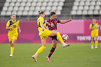 KASHIMA, JAPAN - AUGUST 5: Alanna Kennedy #14 of Australia battles for the ball with Carli Lloyd #10 of the United States during a game between Australia and USWNT at Kashima Soccer Stadium on August 5, 2021 in Kashima, Japan.