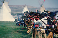 Mountainmen compete in muzzleloader marksmanship contest. buckskin clothing, guns, weapons, accessiories, teepees in background. Fort Bridger Wyoming.