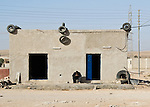 """""""Blue Door"""" -- A small shop by the side of the """"desert highway,"""" south of Amman Jordan.  © Rick Collier"""