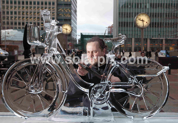 **ALL ROUND PICTURES FROM SOLARPIX.COM**                                             **NO UK NEWSPAPER PUBLICATION**.**UK MAGAZINE & SUPPLEMENT PUBLICATION ONLY** AND NO PUBLICATION IN AUSTRALIA, BELGIUM, FRANCE, GERMANY, ITALY, SCANDINAVIA AND USA**                                                                                  Caption: Sculptor Krisztian Pogany puts the finishing touches to an ice bike in Canada Square Park in Canary Wharf . The sculpture is part of the London Ice Sculpting Festival, a three day event that includes polar bear sculpting classes for the public and speed competitions for the professionals. Canary Wharf, London, UK. 13 January 2011..                                                                              This pic: Krisztian Pogany                                                                                             JOB REF: 12662 SFE       DATE: 13_01_2011                                                           **MUST CREDIT SOLARPIX.COM OR DOUBLE FEE WILL BE CHARGED**                                                                      **MUST AGREE FEE BEFORE ONLINE USAGE**                               **CALL US ON: +34 952 811 768 or LOW RATE FROM UK 0844 617 7637**