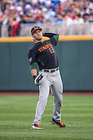 Willie Abreu (13) of the Miami Hurricanes throws during a game between the Miami Hurricanes and Florida Gators at TD Ameritrade Park on June 13, 2015 in Omaha, Nebraska. (Brace Hemmelgarn/Four Seam Images)