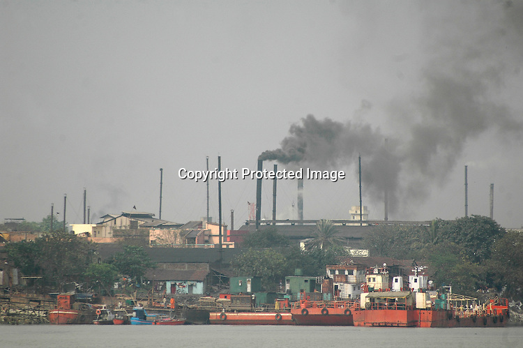 INDIA (West Bengal - Calcutta) 2007,A factroy emmiting black smoke. In India coal is still the primary fuel used in most of the small factories. These factories are anoher air polluting agent in the city. A recent report by CNIC (CHITTARANJAN NATIONALCANCER INSTITUTE)  one of the most prominent cancer Institue of the country declairs Calcutta has the most air pollution in the country and 70% of its population suffers from respiratory and lung diseases. - Arindam Mukherjee