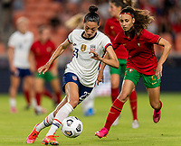 HOUSTON, TX - JUNE 10: Christen Press #23 of the USWNT dribbles during a game between Portugal and USWNT at BBVA Stadium on June 10, 2021 in Houston, Texas.