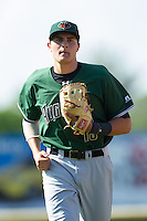 Ryder Jones (15) of the Augusta GreenJackets jogs off the field between innings of the South Atlantic League game against the Hickory Crawdads at L.P. Frans Stadium on May 11, 2014 in Hickory, North Carolina.  The GreenJackets defeated the Crawdads 9-4.  (Brian Westerholt/Four Seam Images)