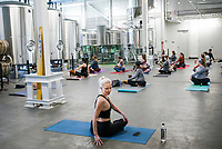 Yoga Story instructor Maddie Hernandezleads a yoga class, Saturday, February 13, 2021 at the Bentonville Brewing Company in Bentonville. The brewhaus hosted a free yoga class inside the brewery due to the cold weather. Check out nwaonline.com/210213Daily/ for today's photo gallery. <br /> (NWA Democrat-Gazette/Charlie Kaijo)