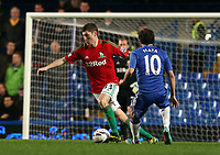 Wednesday 09 January 2013<br /> Pictured L-R: Ben Davies of Swansea against Juan Mata of Chelsea<br /> Re: Capital One Cup semifinal, Chelsea FC v Swansea City FC at the Stamford Bridge Stadium, London.