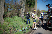 one of the pre-race favourites Sep Vanmarcke (BEL/LottoNL-Jumbo) is stranded with a mechanical after a crash and awaits the teamcar to bring a new bike together with teammate Robert Wagner (DEU/LottoNL-Jumbo)<br /> <br /> 100th Ronde van Vlaanderen 2016