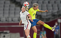 TOKYO, JAPAN - JULY 20: Julie Ertz #8 of the United States and Lina Hurtig #8 of Sweden get after a ball in the air during a game between Sweden and USWNT at Tokyo Stadium on July 20, 2021 in Tokyo, Japan.