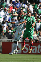 Luis Miguel Noriega (19) heads the ball over Wilber Sanchez (9). Mexico defeated Nicaragua 2-0 during the First Round of the 2009 CONCACAF Gold Cup at the Oakland, Coliseum in Oakland, California on July 5, 2009.