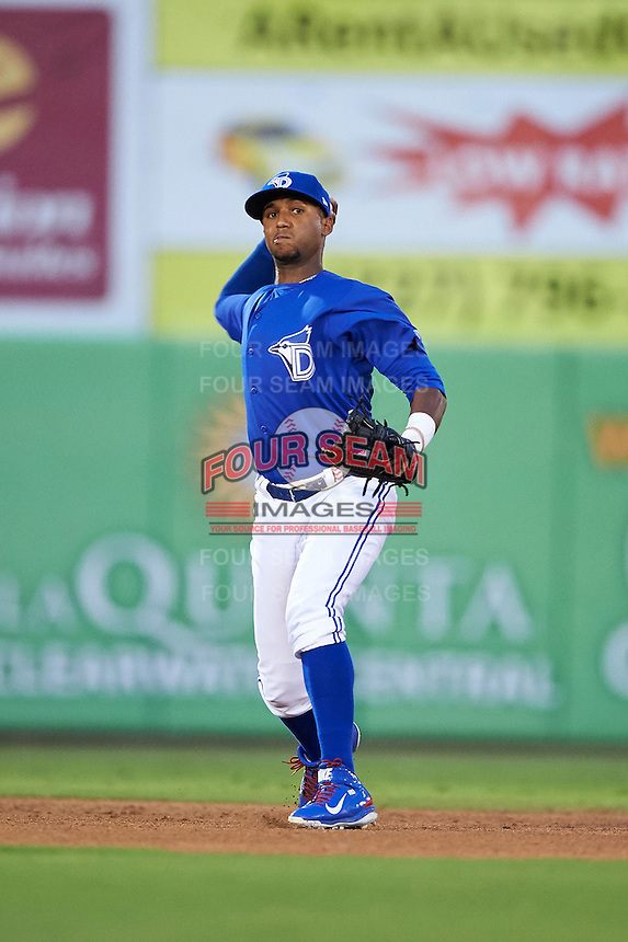 Dunedin Blue Jays shortstop Richard Urena (7) throws to first during the second game of a doubleheader against the Palm Beach Cardinals on July 31, 2015 at Florida Auto Exchange Stadium in Dunedin, Florida.  Dunedin defeated Palm Beach 4-0.  (Mike Janes/Four Seam Images)