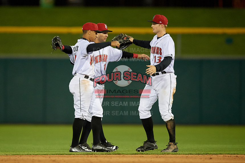 Indianapolis Indians Chris Bostick (7), Danny Ortiz (12) and Austin Meadows (13) celebrate closing out a game against the Toledo Mud Hens on May 2, 2017 at Victory Field in Indianapolis, Indiana.  Indianapolis defeated Toledo 9-2.  (Mike Janes/Four Seam Images)