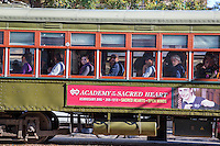 Garden District, New Orleans, Louisiana.  Passengers on the St. Charles Streetcar.