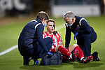 Dundee v St Johnstone…22.09.21  Dens Park.    Premier Sports Cup<br />James Brown gets treatment for an injury<br />Picture by Graeme Hart.<br />Copyright Perthshire Picture Agency<br />Tel: 01738 623350  Mobile: 07990 594431