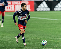 FOXBOROUGH, MA - NOVEMBER 20: Carles Gil #22 of New England Revolution looks to pass during the Audi 2020 MLS Cup Playoffs, Eastern Conference Play-In Round game between Montreal Impact and New England Revolution at Gillette Stadium on November 20, 2020 in Foxborough, Massachusetts.