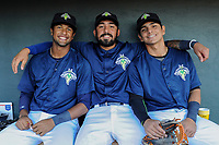 Columbia Fireflies teammates from Venezuela pose for a photo in the dugout before a game against the Lexington Legends on Thursday, June 8, 2017, at Spirit Communications Park in Columbia, South Carolina. From left are Luis Carpio, Ali Sanchez and Andres Gimenez. (Tom Priddy/Four Seam Images)