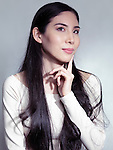 Beauty portrait of a young Japanese woman with long black hair isolated on gray background Image © MaximImages, License at https://www.maximimages.com