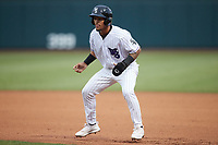Jose Rodriguez (24) of the Winston-Salem Dash takes his lead off of first base against the Greensboro Grasshoppers at Truist Stadium on August 11, 2021 in Winston-Salem, North Carolina. (Brian Westerholt/Four Seam Images)