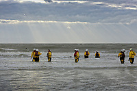 RNLI crew in the sea