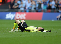 28th May 2018, Wembley Stadium, London, England;  EFL League 2 football, playoff final, Coventry City versus Exeter City; Goalkeeper Christy Pym of Exeter City lying on the pitch in dejection after the final whistle