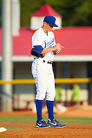 Burlington Royals relief pitcher Eric Sandness (37) rubs up the baseball during the game against the Greeneville Astros at Burlington Athletic Park on June 30, 2014 in Burlington, North Carolina.  The Royals defeated the Astros 9-8. (Brian Westerholt/Four Seam Images)