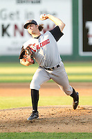 Andrew Leenhouts #39 of the Salem-Keizer Volcanoes delivers a pitch during a game against the Everett AquaSox at Everett Memorial Stadium in Everett, Washington on July 14, 2014.  Salem-Keizer defeated Everett 6-4.  (Ronnie Allen/Four Seam Images)