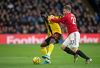 Ismaïla Sarr of Watford & Luke Shaw of Man Utd during the Premier League match between Watford and Manchester United at Vicarage Road, Watford, England on 22 December 2019. Photo by Andy Rowland.