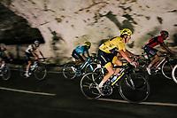 yellow jersey / GC leader Geraint Thomas (GBR/SKY) rolling through a huge dark cave: the 'Grotte du Mas-d'Azil'<br /> <br /> Stage 16: Carcassonne > Bagnères-de-Luchon (218km)<br /> <br /> 105th Tour de France 2018<br /> ©kramon