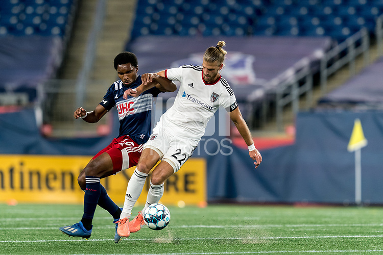 FOXBOROUGH, MA - SEPTEMBER 09: Marky Hernandez #20 of Chattanooga Red Wolves SC dribbles at midfield as Jon Bell #70 of New England Revolution II defends during a game between Chattanooga Red Wolves SC and New England Revolution II at Gillette Stadium on September 09, 2020 in Foxborough, Massachusetts.