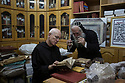 Jerusalem - Father Columba and Abouna Shimon Can, is a Syriac monk responsible for the library of the St. Mark's Syrian Orthodox Monastery Church, look at and ancient manuscript in the library of the Syriac Monastery.