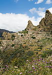 Italy, Calabria, Pentedattilo: one of the most characteristic places of Calabria, secluded mountain village (ghost town) at mountain Monte Calvario with churches SS. Pietro e Paolo, Madonna della Candelora and the ruins of a dominican monastery